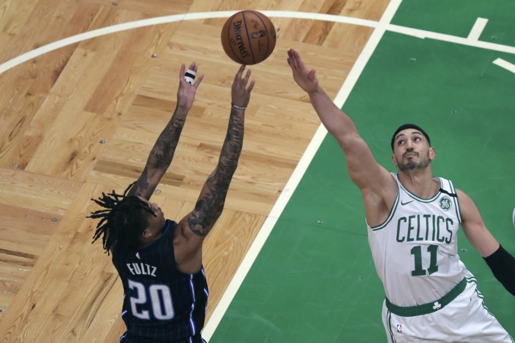 Boston Celtics center Enes Kanter (11) tries to block a shot by Orlando Magic guard Markelle Fultz (20) during the first quarter of an NBA basketball ...
