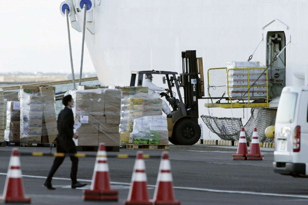 An official overseas the loading of supplies to the cruise ship Diamond Princess which is anchored at Yokohama Port in Yokohama, south of Tokyo, Thurs...
