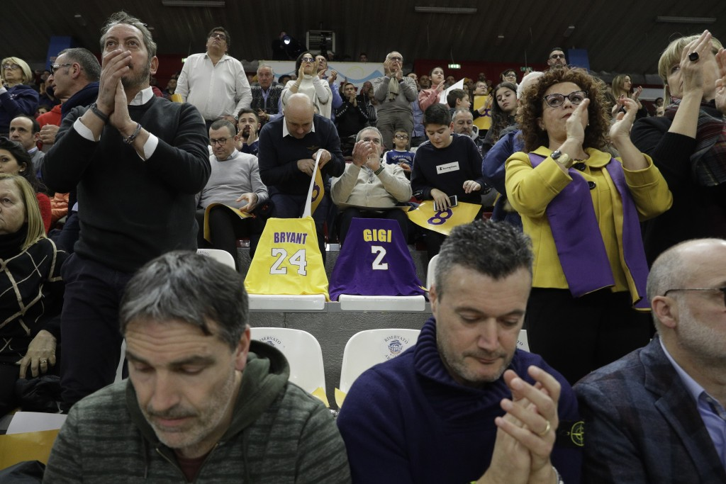 Spectators pay tribute to basketball legend Kobe Bryant and his daughter Gianna Maria prior to the start of the Italian Basketball second division mat...