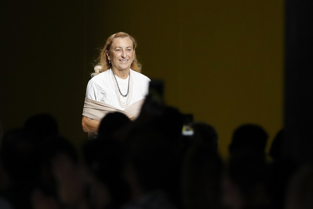 In this Sept. 20, 2018 file photo, Italian designer Miuccia Prada smiles after presenting her women's 2019 Spring-Summer collection, unveiled during t...