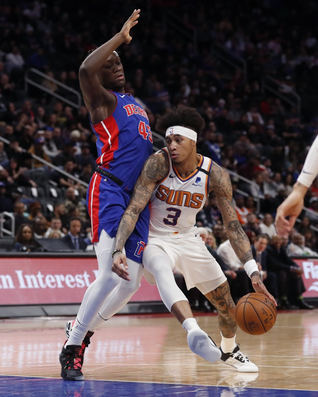 Phoenix Suns forward Kelly Oubre Jr. (3) runs into Detroit Pistons forward Sekou Doumbouya (45) during the first half of an NBA basketball game, Wedne...