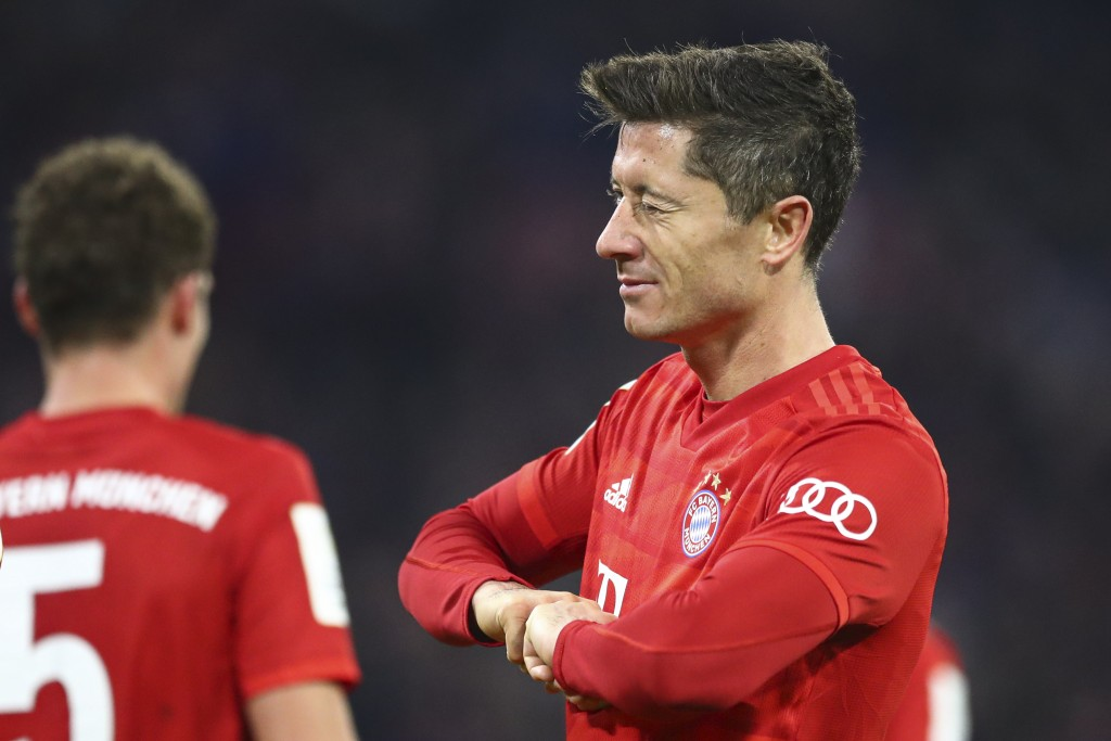Bayern's Robert Lewandowski winks as he celebrates after scoring his side's fourth goal during the German soccer cup, DFB Pokal, match between FC Baye...