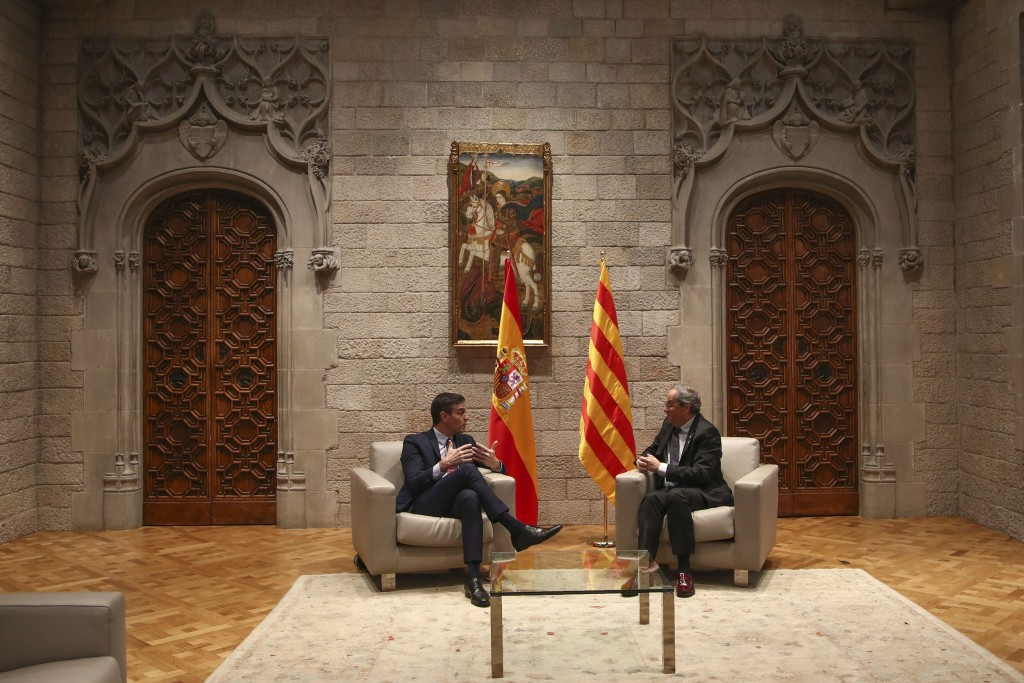 Spanish Prime Minister Pedro Sanchez, left, talks with Catalan regional President Quim Torra at the Palace of the Generalitat, the headquarter of the ...