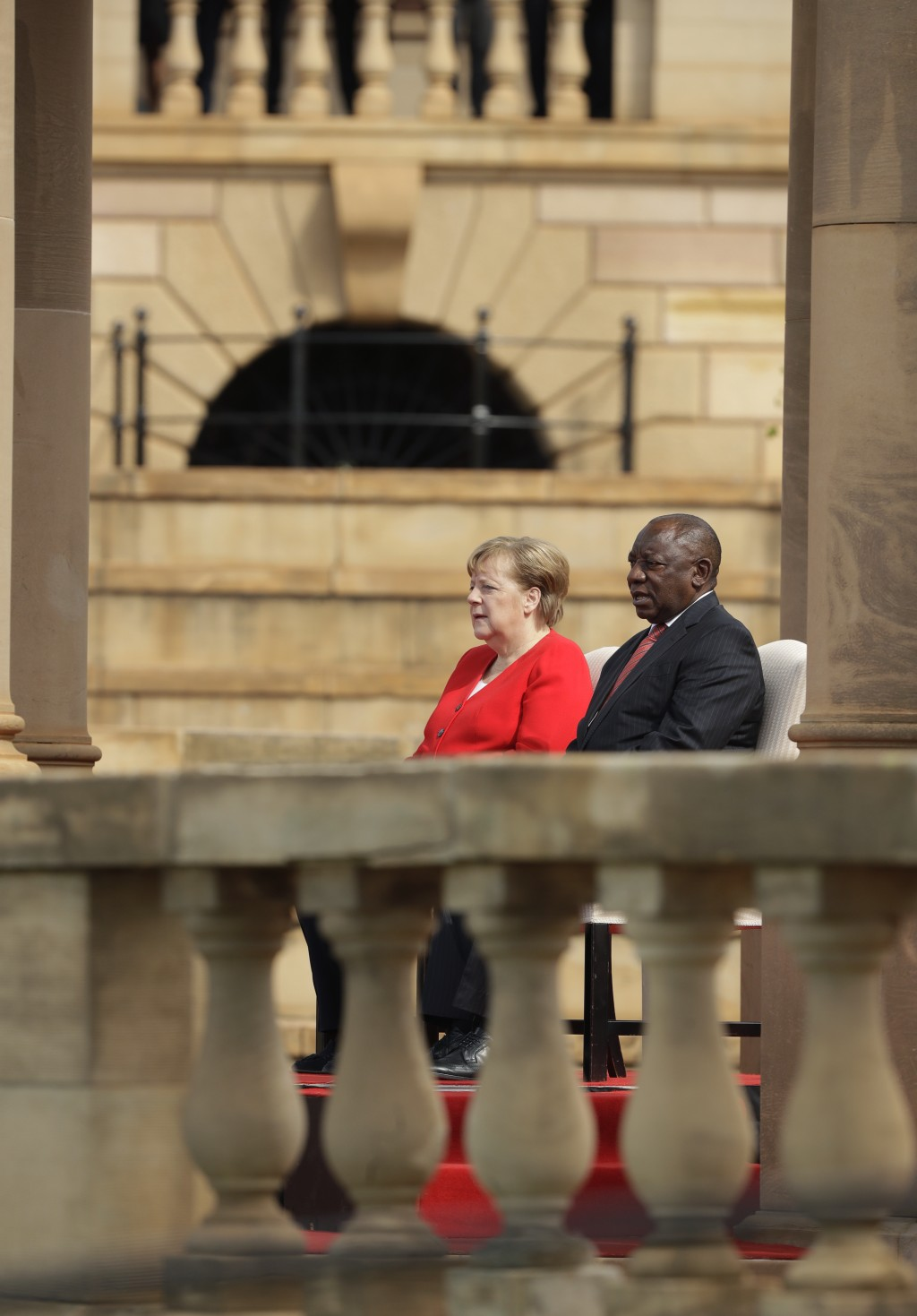 German Chancellor Angela Merkel, left, sits with South African President Cyril Ramaphosa, during a welcoming ceremony at the government's Union Buildi...