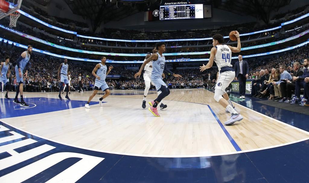 Dallas Mavericks forward Justin Jackson (44) handles the ball as Memphis Grizzlies guard Ja Morant (12) defends during the first half of an NBA basket...