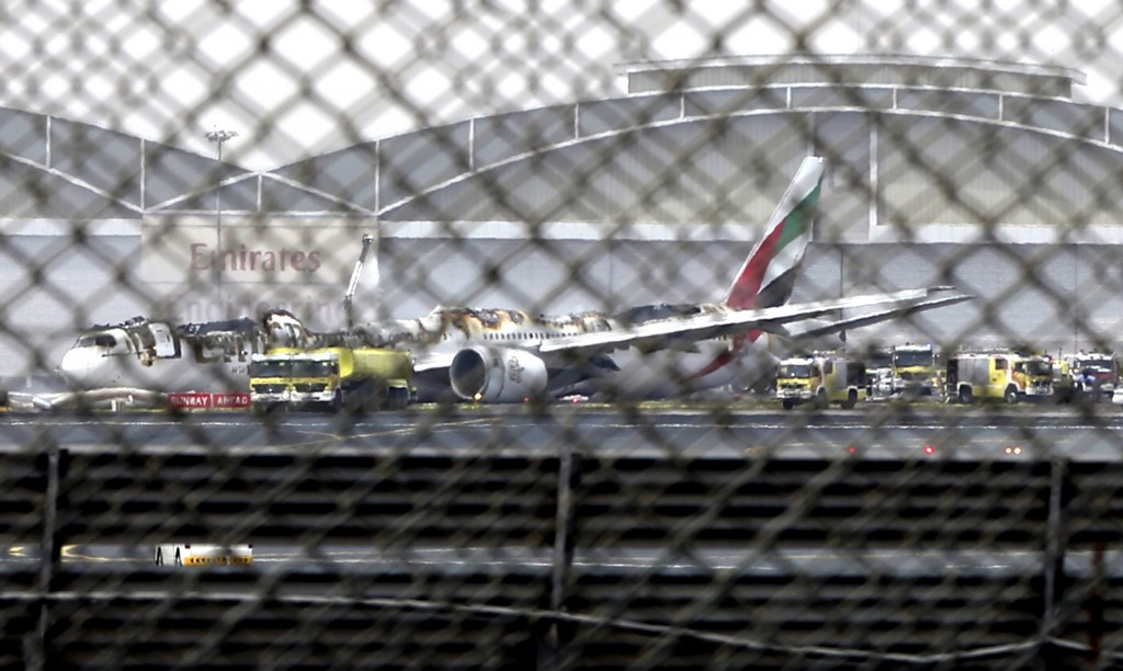 FILE - In this Aug 3, 2016 file photo, a damaged Boeing 777 is seen at the Dubai airport after it crash-landed, in Dubai, United Arab Emirates. An inv...