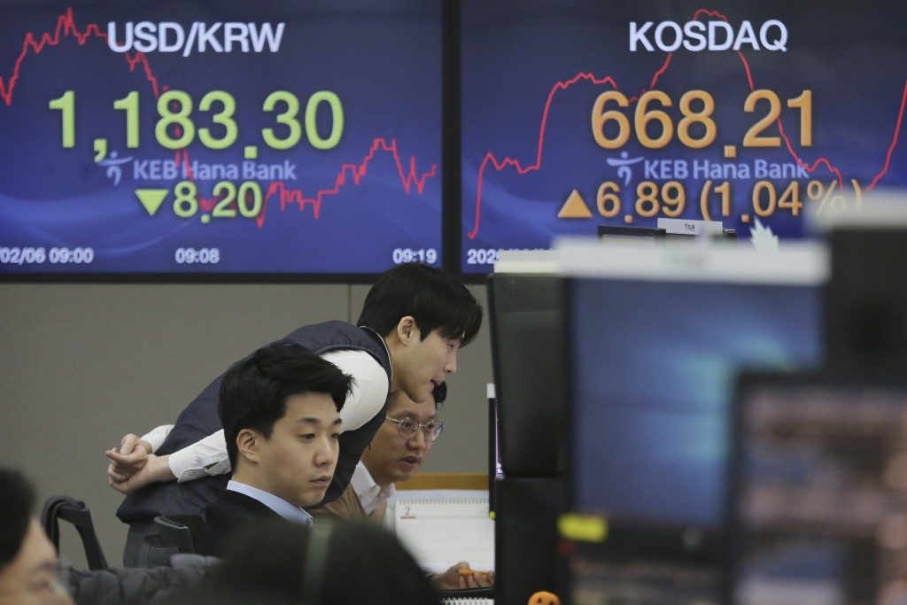 Currency traders watch monitors at the foreign exchange dealing room of the KEB Hana Bank headquarters in Seoul, South Korea, Thursday, Feb. 6, 2020. ...