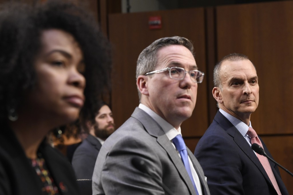 U.S. Anti-Doping Agency Chief Executive Officer Travis Tygart, right, sitting with U.S. Center for SafeSport Chief Executive Officer U'Riese Colón, le...