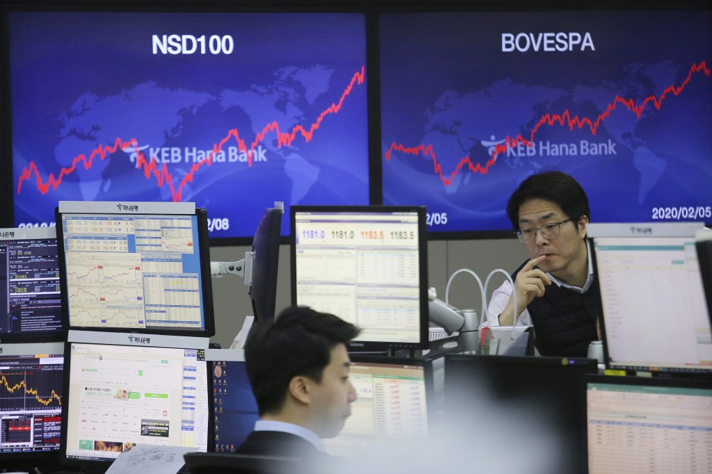 A currency trader watches monitors at the foreign exchange dealing room of the KEB Hana Bank headquarters in Seoul, South Korea, Thursday, Feb. 6, 202...