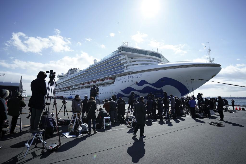 The cruise ship Diamond Princess is anchored at Yokohama Port for supplies replenished in Yokohama, south of Tokyo, Thursday, Feb. 6, 2020. Health wor...