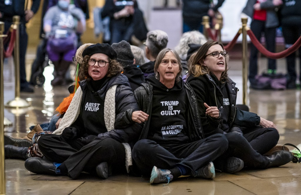 Anti-Trump protestors demonstrate in the Rotunda of the the Capitol in Washington, Wednesday, Feb. 5, 2020, during the impeachment trial of President ...