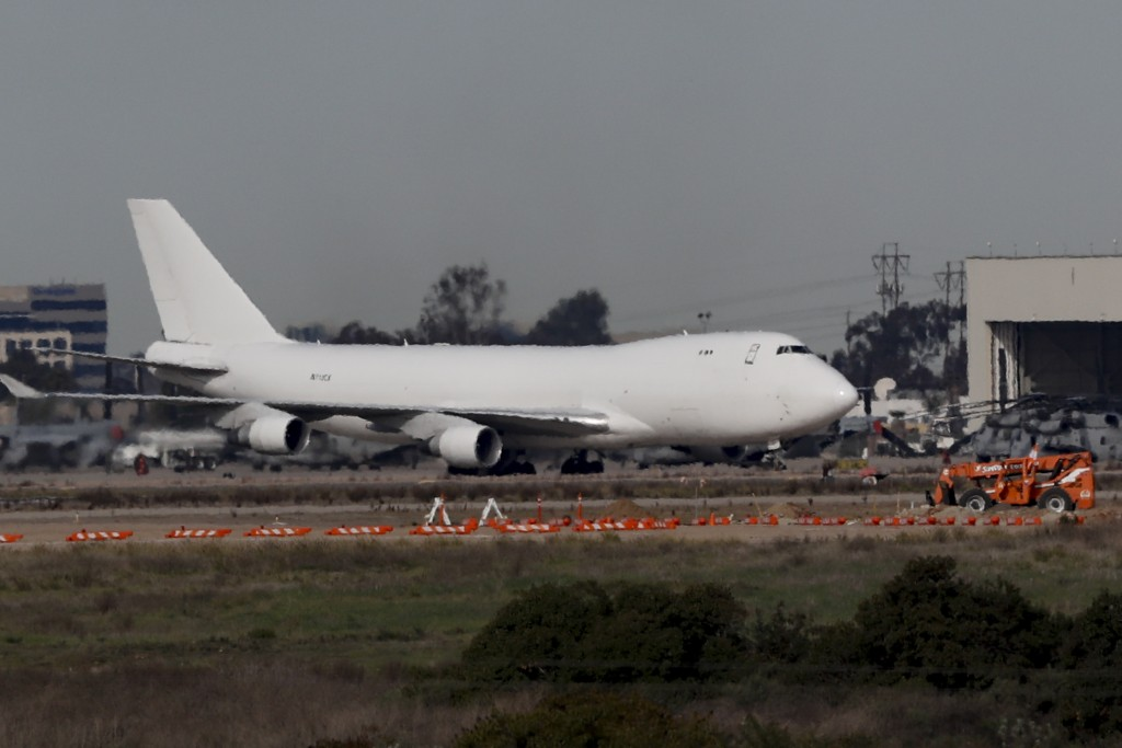 A plane carrying evacuees from the virus zone in China lands at Marine Corps Air Station Miramar Wednesday, Feb. 5, 2020, in San Diego. One of two jet...