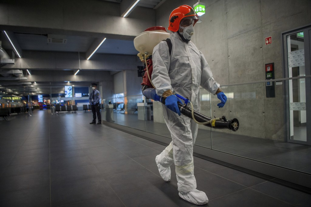 Disinfection equipment is carried by a worker as precautionary measures against the spreading of novel coronavirus, at Budapest Liszt Ferenc Internati...