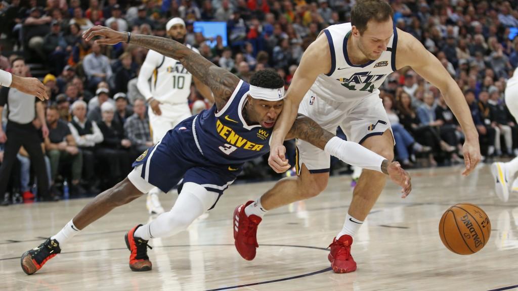 Denver Nuggets forward Torrey Craig (3) and Utah Jazz forward Bojan Bogdanovic (44) battle for a loose ball in the first half during an NBA basketball...