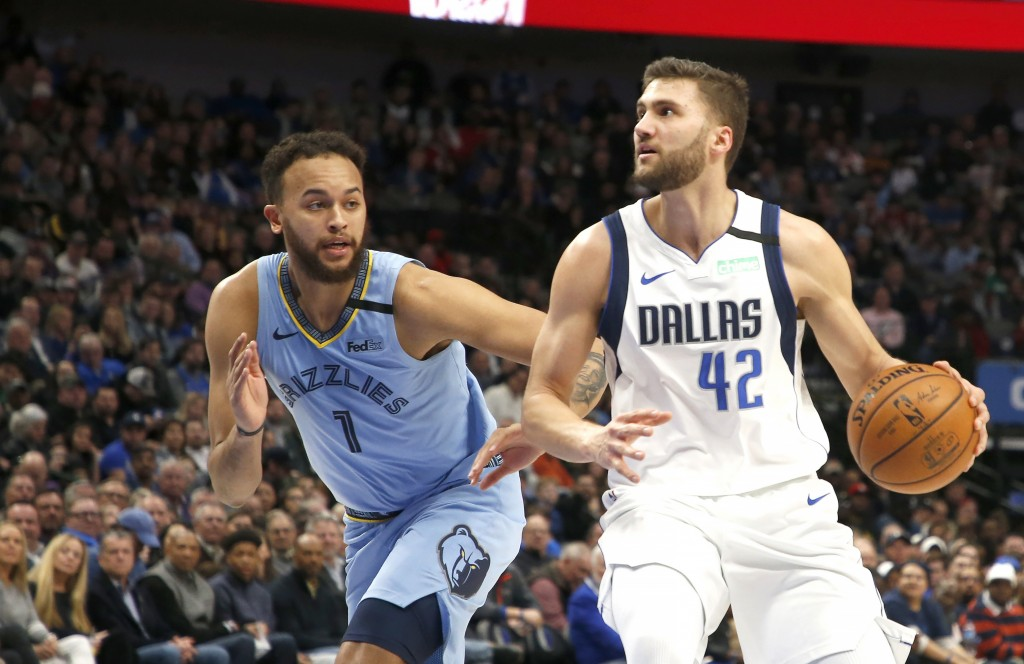Dallas Mavericks forward Maxi Kleber (42) drives inside as Memphis Grizzlies forward Kyle Anderson (1) defends during the first half of an NBA basketb...