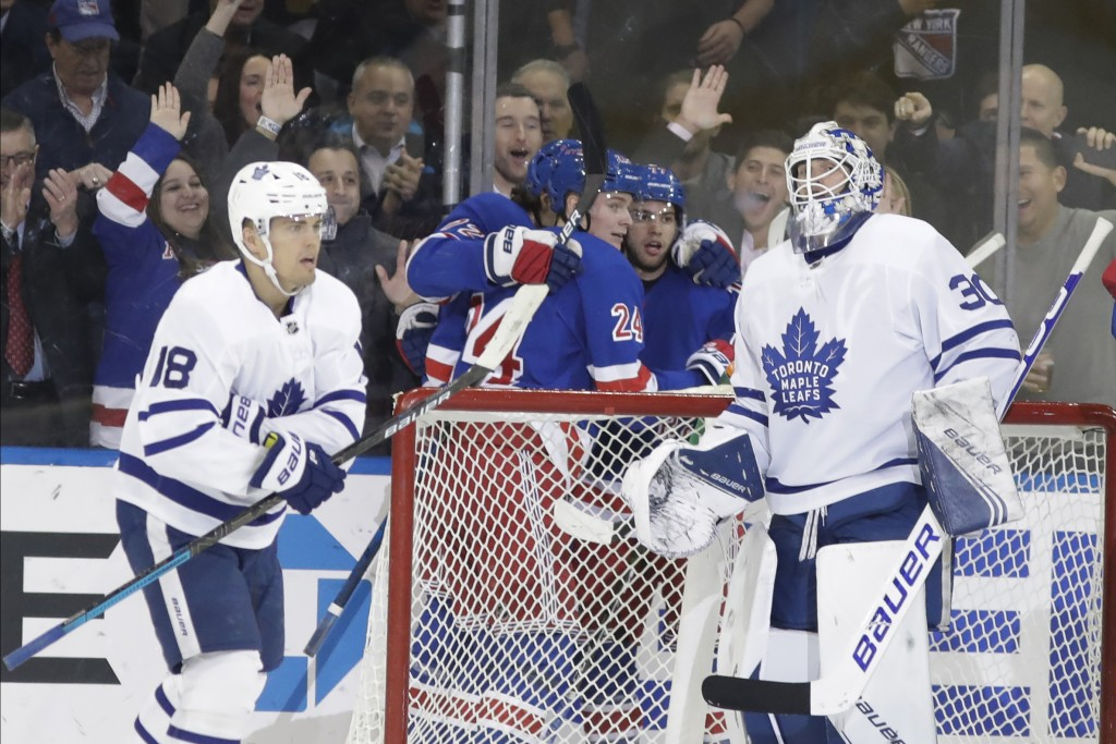 Toronto Maple Leafs goaltender Michael Hutchinson (30) and Andreas Johnsson (18) react as the New York Rangers celebrate a goal by Filip Chytil during...