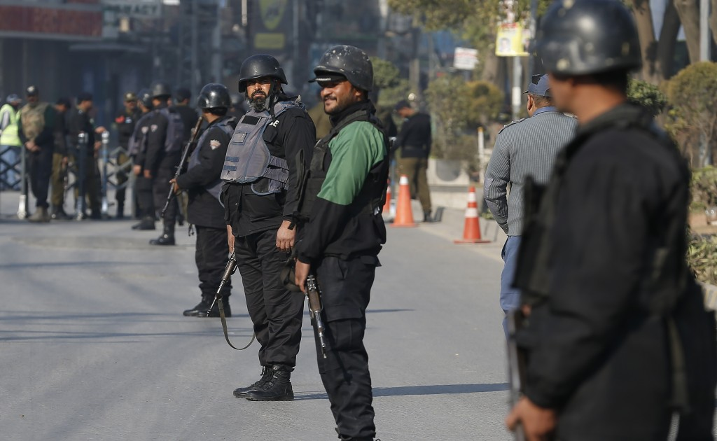 Police commandos stand guard on the arrival of the Bangladesh cricket team for a practice session at the Pindi Cricket Stadium in Rawalpindi, Pakistan...