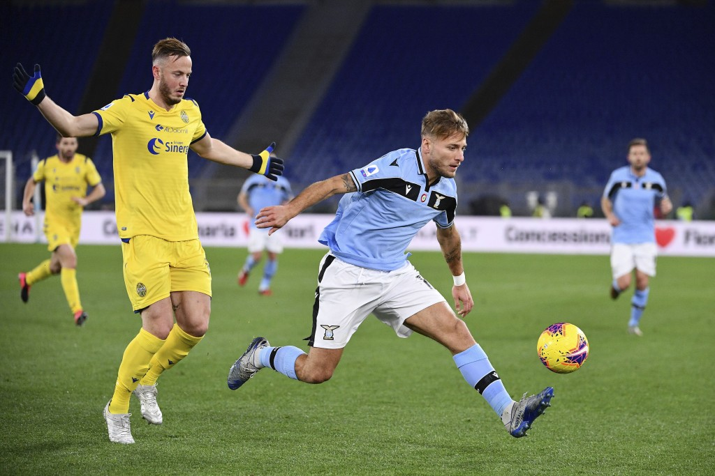 Lazio's Ciro Immobile, right, in action during the Italian Serie A soccer match between Lazio and Hellas Verona at the Stadio Olimpico in Rome, Wednes...