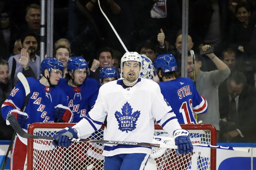 Toronto Maple Leafs' Cody Ceci (83) reacts as the New York Rangers celebrates a goal by Filip Chytil during the first period of an NHL hockey game Wed...