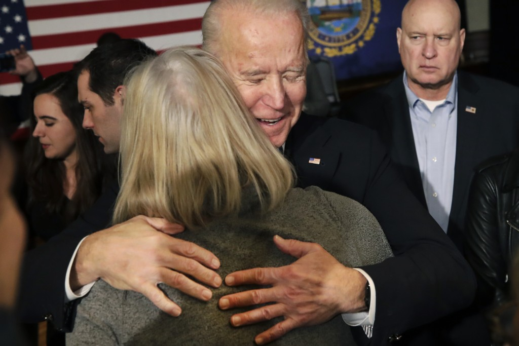 Democratic presidential candidate former Vice President Joe Biden hugs a woman at a campaign event, Wednesday, Feb. 5, 2020, in Somersworth, N.H. (AP ...
