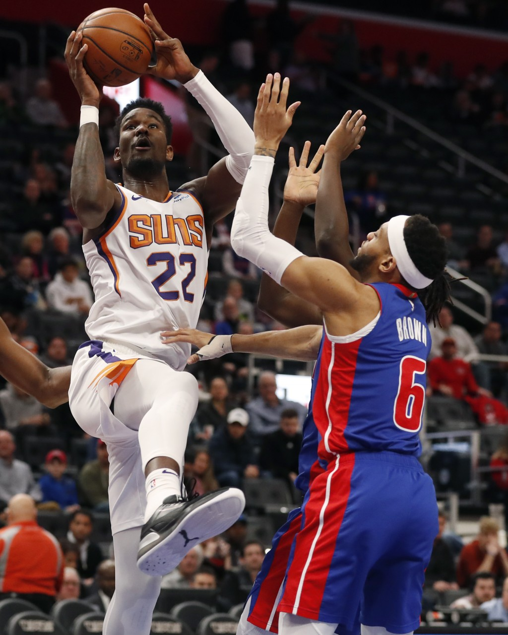 Phoenix Suns center Deandre Ayton (22) shoots over Detroit Pistons guard Bruce Brown (6) during the first half of an NBA basketball game, Wednesday, F...