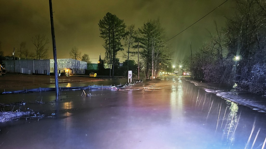 This photo provided by Pelham Police Dept. shows a flooded street in Pelham, Ala., early Thursday, Feb. 6, 2020. A powerful winter storm delivered sev...