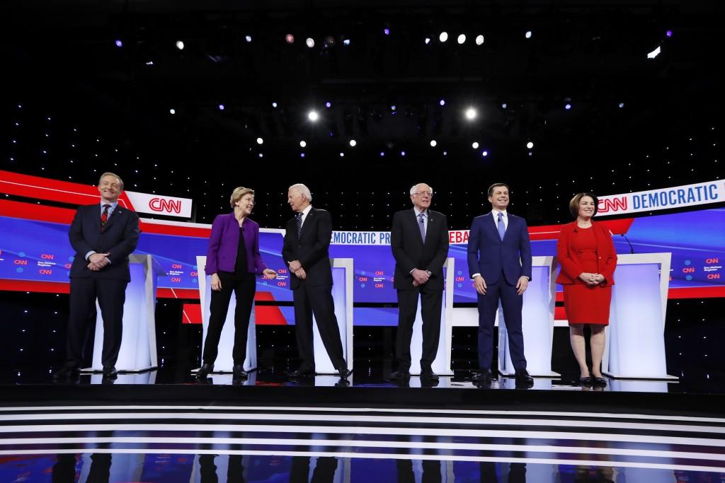 FILE - In this Tuesday, Jan. 14, 2020, file photo, from left, Democratic presidential candidates businessman Tom Steyer, Sen. Elizabeth Warren, former...