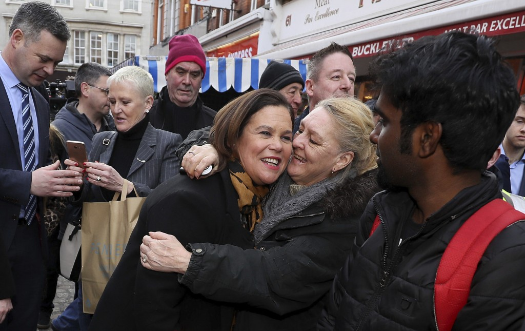 Sinn Fein leader Mary Lou McDonald, center, is greeted by well wishers during a walkabout in central Dublin during a walkabout in central Dublin, whil...