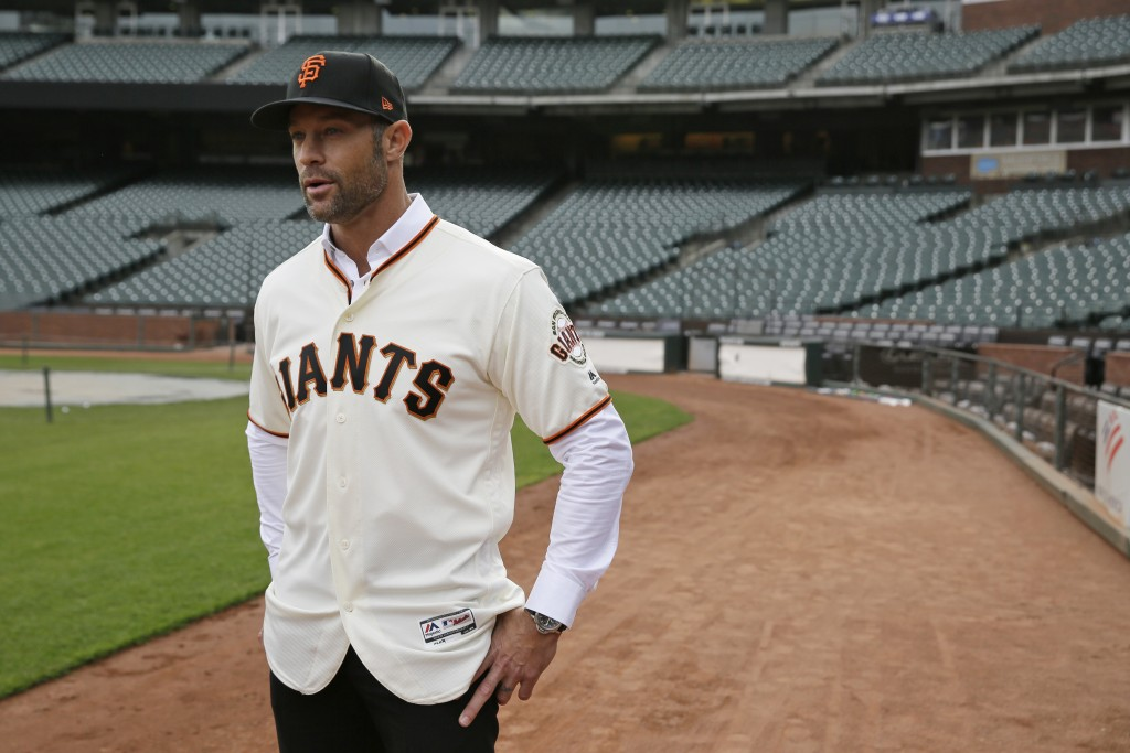 FILE - In this Nov. 13, 2019, file photo, San Francisco Giants manager Gabe Kapler stands on the field and looks out at Oracle Park in San Francisco a...