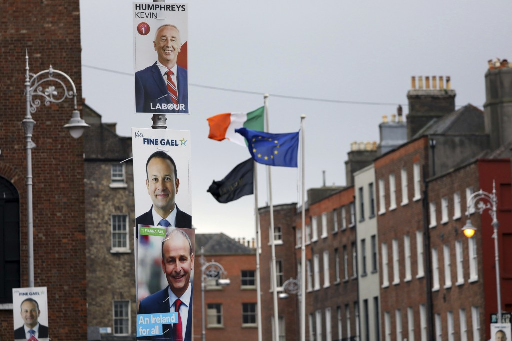 Election posters are displayed on lampposts outside the Irish Prime Minister offices in Dublin, Ireland, Friday, Feb. 7, 2020. Irish voters will choos...