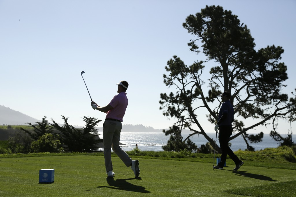 Chase Seiffert follows his shot from the fifth tee of the Pebble Beach Golf Links during the first round of the AT&T Pebble Beach National Pro-Am golf...