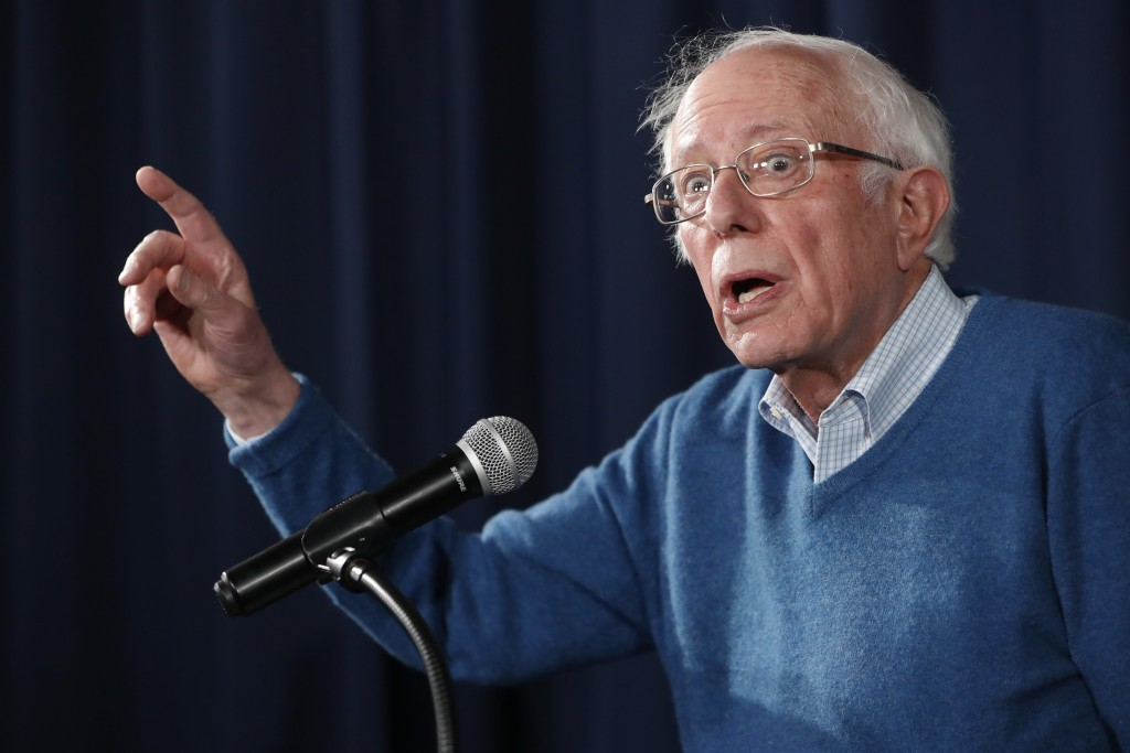 Democratic presidential candidate Sen. Bernie Sanders, I-Vt., gestures while speaking during a news conference at his New Hampshire headquarters, Thur...