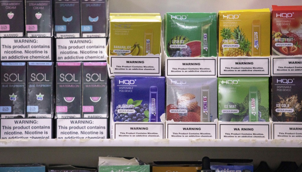 This Jan. 31, 2020 photo shows various brands and flavors of disposable vape devices at a store in the Brooklyn borough of New York. On Thursday, Feb....