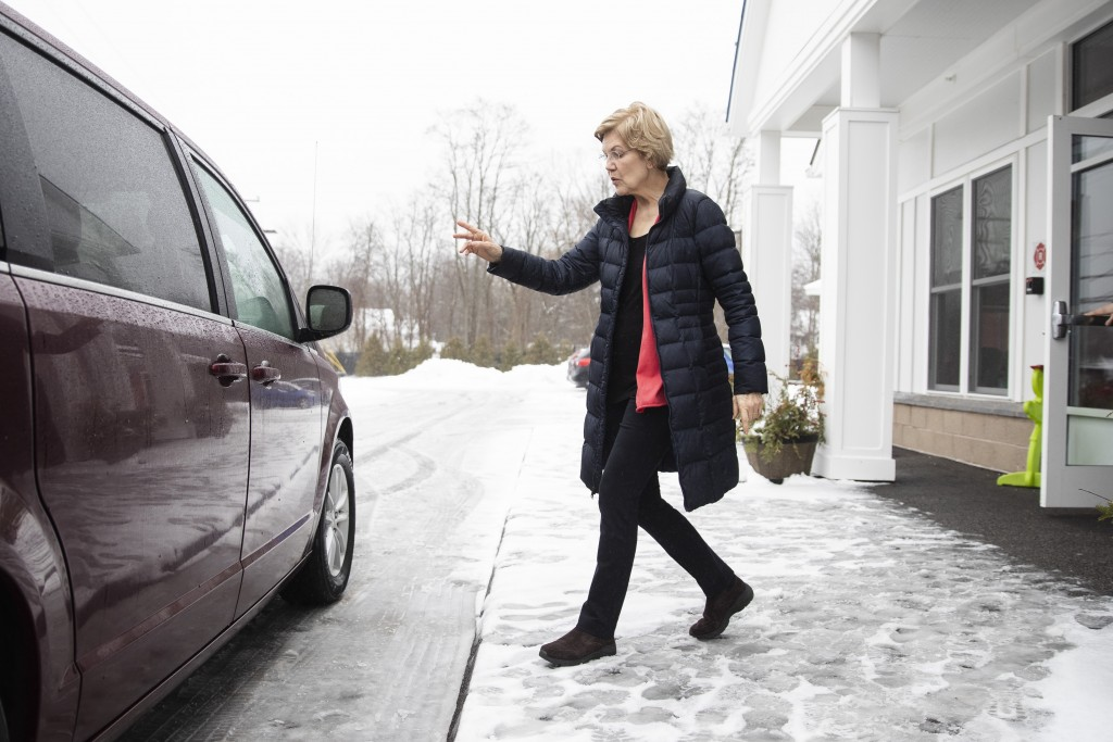 Democratic presidential candidate Sen. Elizabeth Warren, D-Mass., departs after a visit to the Great Bay Kids' Company, Thursday, Feb. 6, 2020, in Exe...