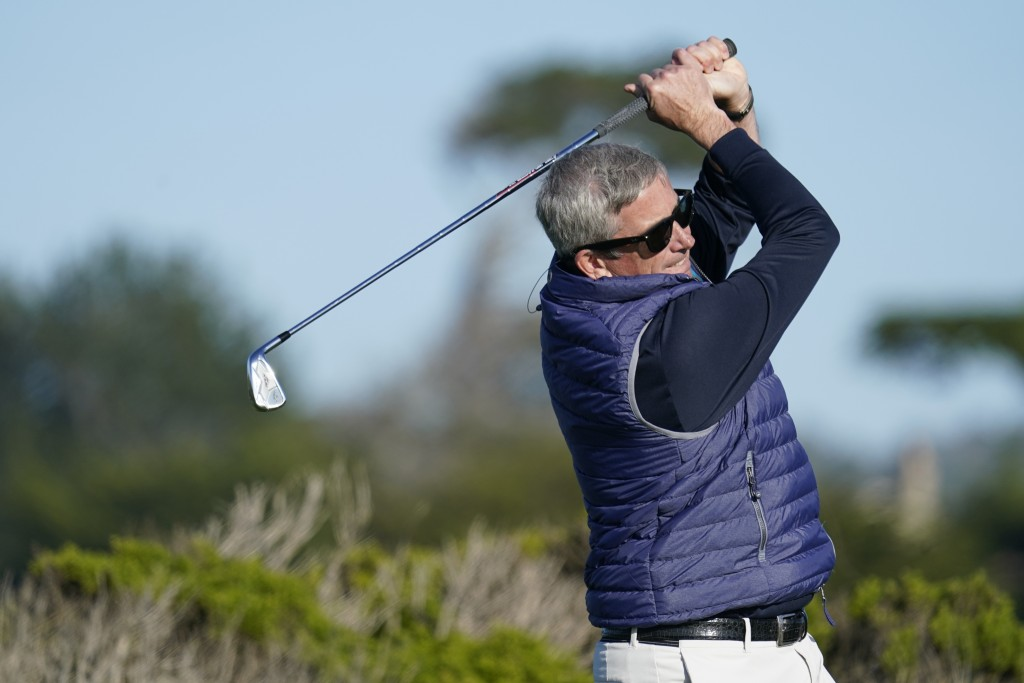 PGA Tour Commissioner Jay Monahan follows his drive from the ninth tee of the Monterey Peninsula County Club Shore Course during the first round of th...