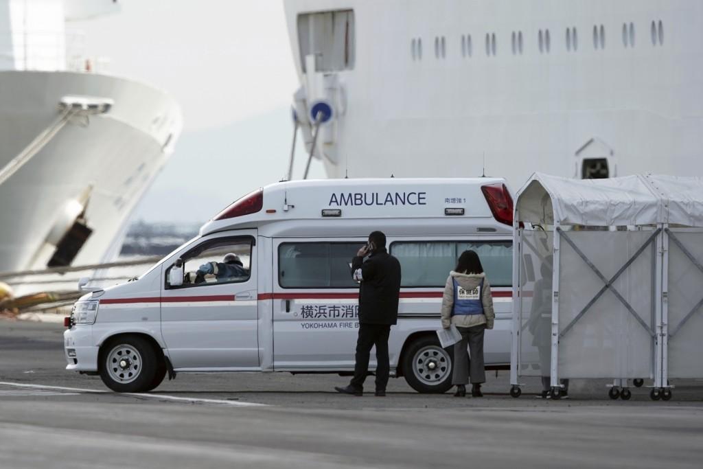 An ambulance arrives at the cruise ship Diamond Princess anchored at Yokohama Port in Yokohama, near Tokyo. Friday, Feb. 7, 2020. Japan on Friday repo...