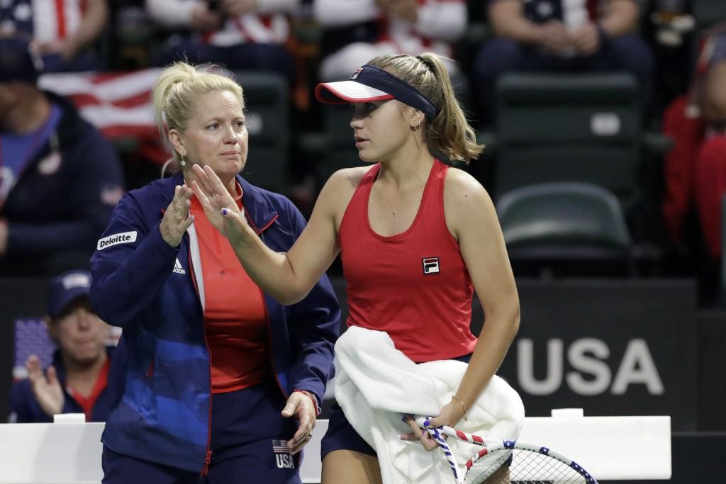 United States' Sofia Kenin, right, is greeted by coach Kathy Rinaldi during a break in Kenin's match against Latvia's Anastasija Sevastova during a Fe...