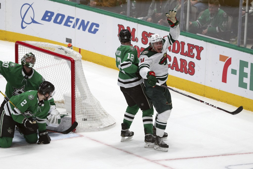 Minnesota Wild center Joel Eriksson Ek (14) celebrates after scoring the winning goal in the third period against the Dallas Stars during an NHL hocke...