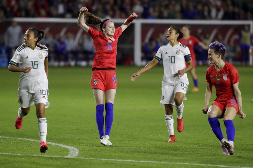 U.S. midfielder Rose Lavelle (16) celebrates after scoring against Mexico during the first half of a CONCACAF women's Olympic qualifying soccer match ...