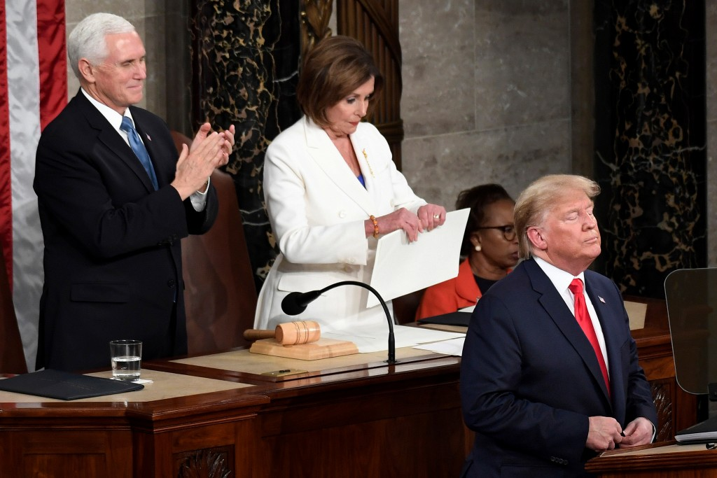 House Speaker Nancy Pelosi, D-Calif., tears her copy of President Donald Trump's s State of the Union address after he delivered it to a joint session...