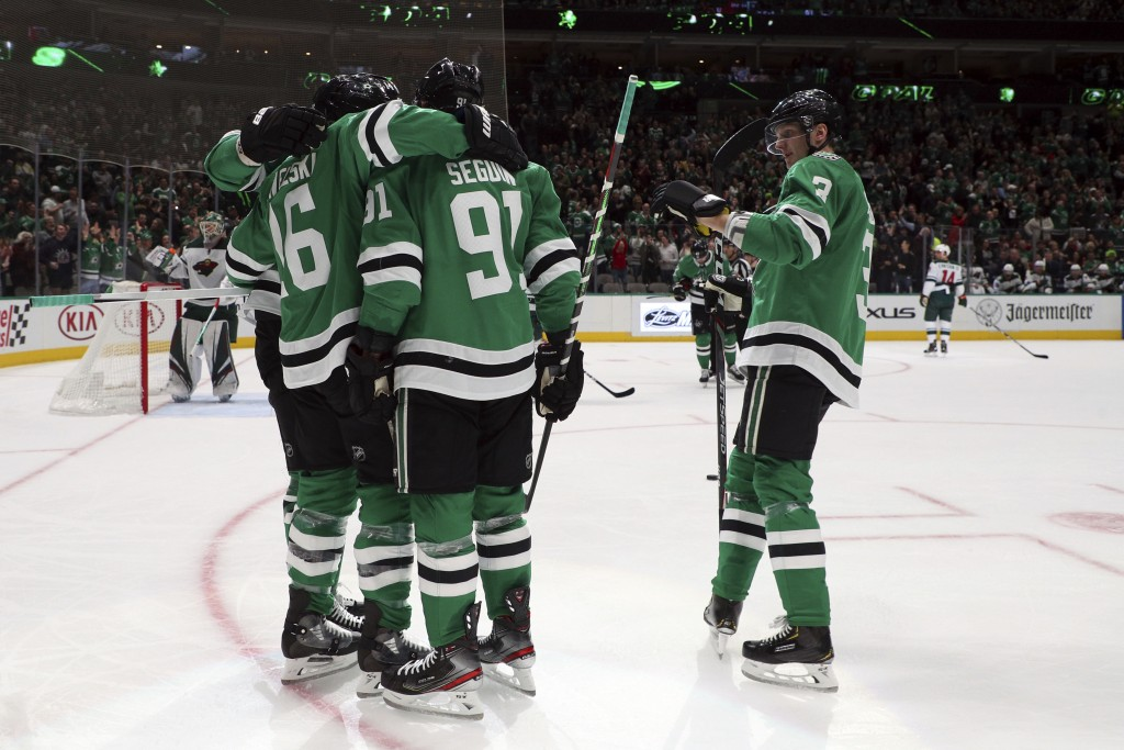 Dallas Stars, including center Joe Pavelski (16), center Tyler Seguin (91) and defenseman John Klingberg (3), celebrate a first-period goal by Pavelsk...
