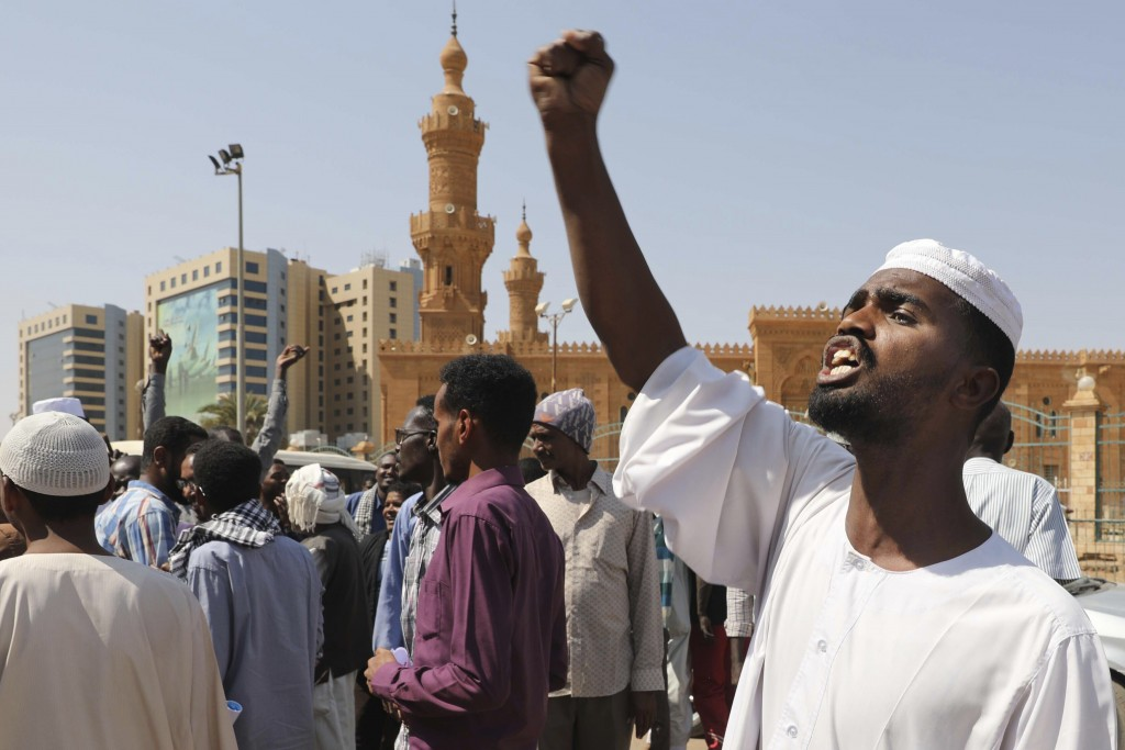 People chant slogans to protest Sudanese President of the Sovereignty Council Abdel Fattah Abdelrahman Burhan's contentious decision to meet Israel's ...
