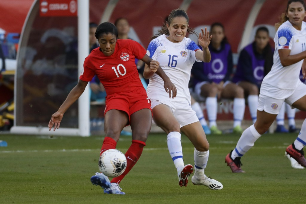 Canada defender Ashley Lawrence, left, kicks the ball past Costa Rica midfielder Katherine Alvarado during the first half of a CONACAF women's Olympic...