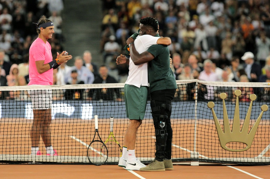 Springbok Captain Siya Kolisi, right, greets Roger Federer while Rafael Nadal looks on ahead of their exhibition tennis match held at the Cape Town St...