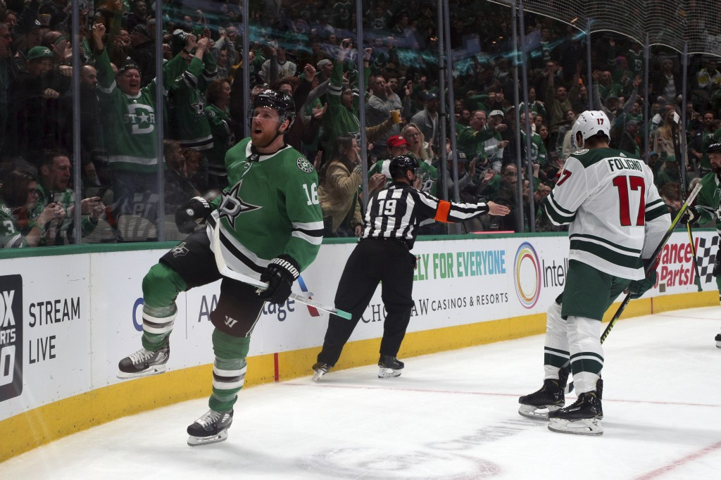 Dallas Stars center Joe Pavelski (16) races after scoring against the Minnesota Wild in the first period during an NHL hockey game Friday, Feb. 7, 202...