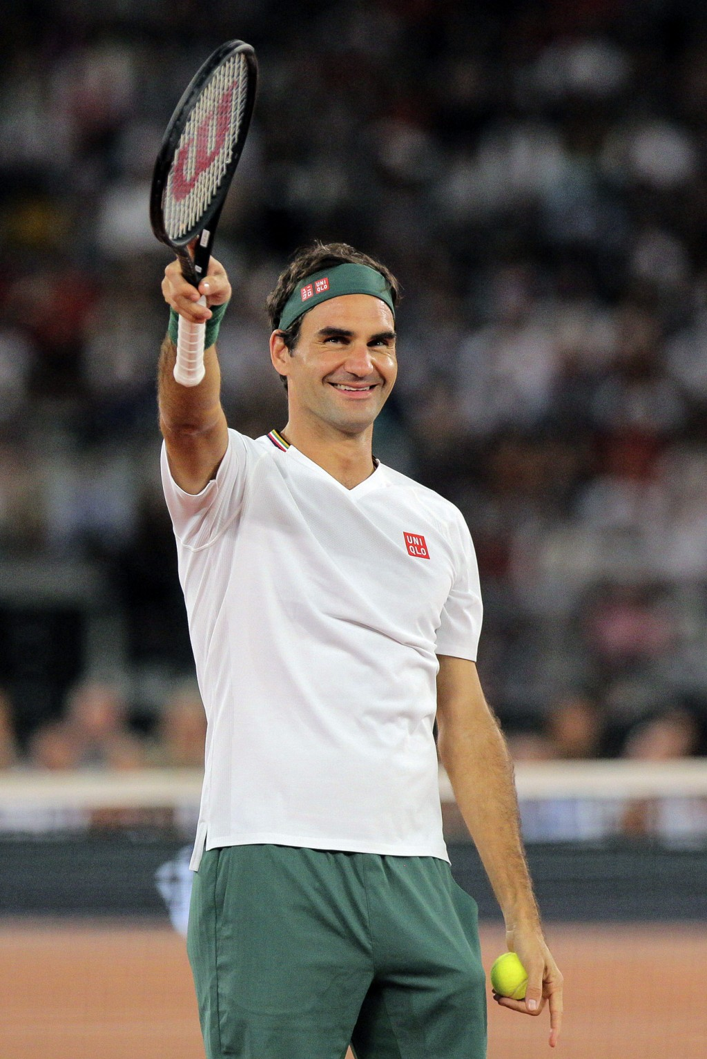 Roger Federer waves at the crowd during the exhibition tennis match against Rafael Nadal held at the Cape Town Stadium in Cape Town, South Africa, Fri...
