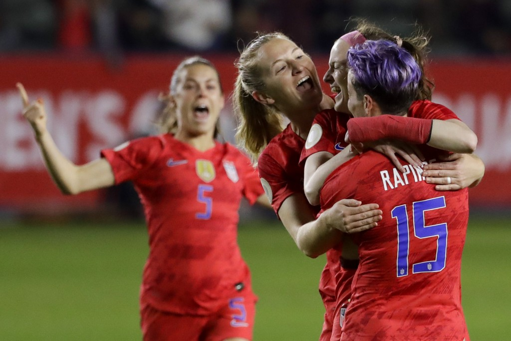 U.S. players celebrate after a goal by midfielder Rose Lavelle, second from right, during the first half of a CONCACAF women's Olympic qualifying socc...