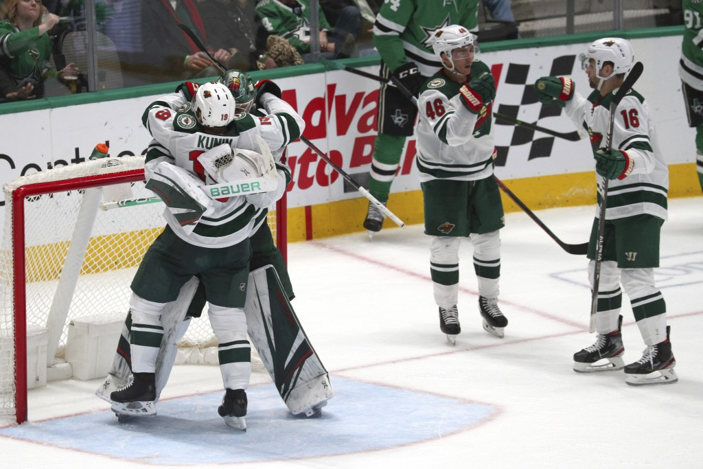The Minnesota Wild celebrate their win over the Dallas Stars during an NHL hockey game Friday, Feb. 7, 2020, in Dallas. (AP Photo/Richard W. Rodriguez...