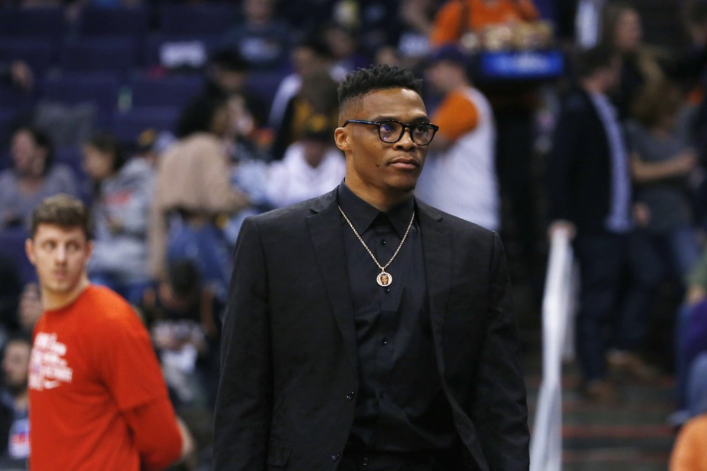 Houston Rockets guard Russell Westbrook leaves the bench area and walks back to the locker room during the first half of an NBA basketball game agains...