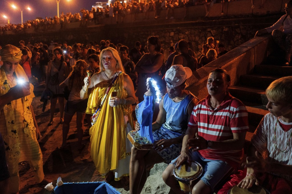 People participate in a ritual for the African sea goddess Yemanja, at a beach in Montevideo, Uruguay, Sunday, Feb. 2, 2020. Thousands of worshippers ...